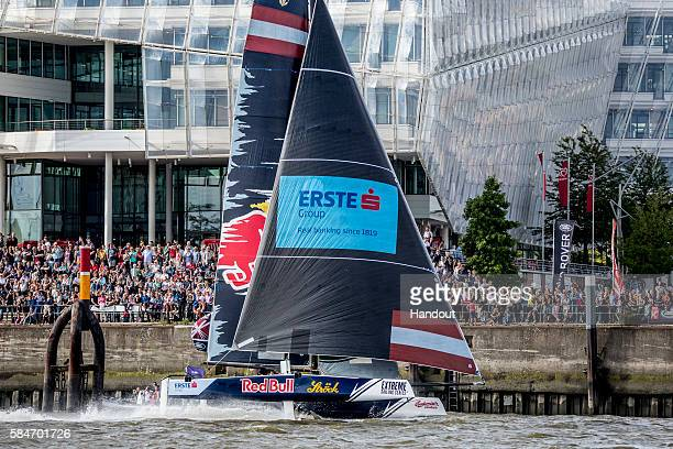 In this handout image provided by Red Bull Red Bull Sailing Team of Austria compete in their GC32 hydrofoiling catamaran during day three of the...