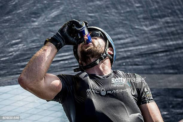 In this handout image provided by Red Bull Red Bull Sailing Team crewman Brad Farrand of New Zealand takes a drink in between races in their GC32...