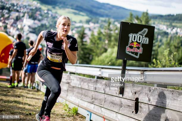 In this handout image provided by Red Bull Relay competitor Maleen Nadler of Germany makes her way up the 400 metre long ski jump course with 140...