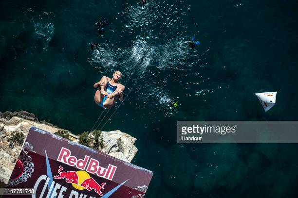 In this handout image provided by Red Bull, Rhiannan Iffland of Australia dives from the 21 metre platform during the final competition day of the...