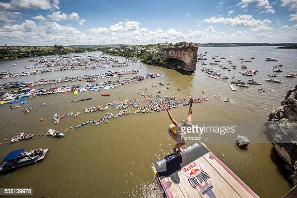 In this handout image provided by Red Bull Rhiannan Iffland of Australia dives from the 20 metre platform on Devil's Island during the first stop of...