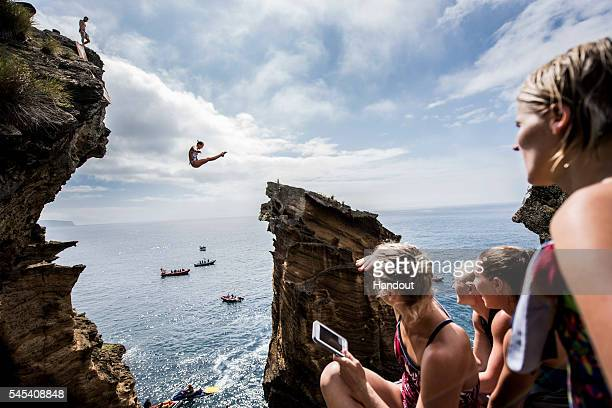 In this handout image provided by Red Bull Rhiannan Iffland of Australia dives 20 metres from rock cliffs at Islet Franca do Campo during the first...