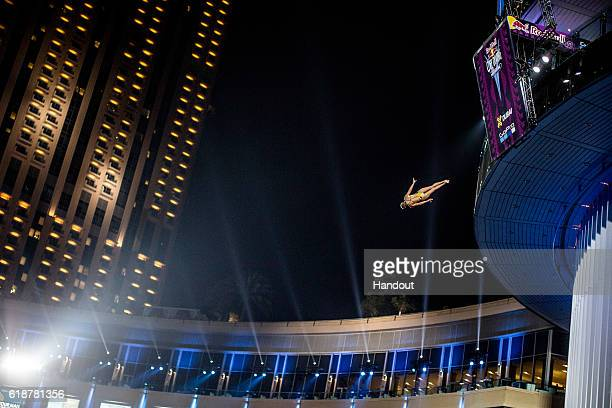 In this handout image provided by Red Bull Rhiannan Iffland of Australia dives from the 205 metre platform on the Dubai Marina Pier 7 building during...