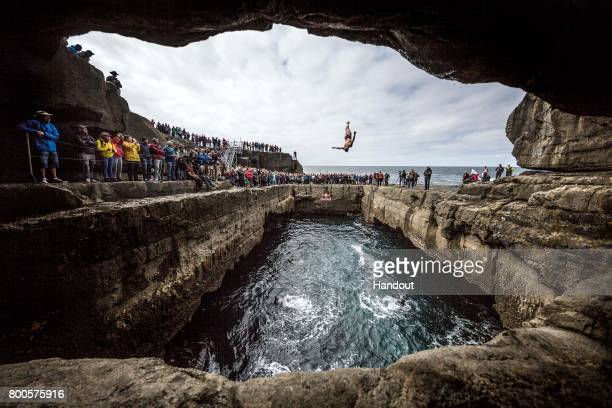 In this handout image provided by Red Bull Rhiannan Iffland of Australia dives from the 21 metre platform at the Serpent`s Lair during the first stop...