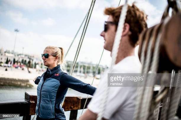 In this handout image provided by Red Bull Rhiannan Iffland of Australia warms up alongside Andy Jones of the USA onboard the caravel Vera Cruz prior...
