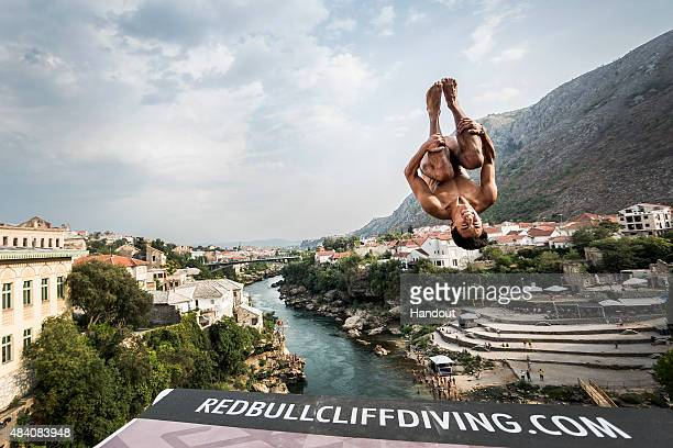 In this handout image provided by Red Bull Sergio Guzman of Mexico dives from the 28 metre platform on the Stari Most bridge during the second...