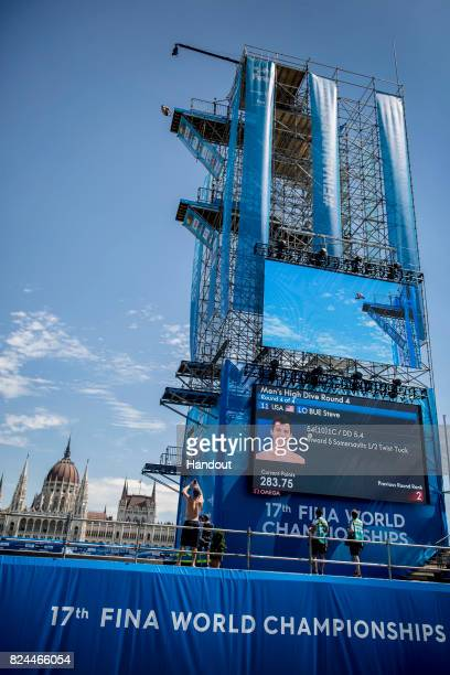 In this handout image provided by Red Bull Steven LoBue of the USA dives from the 27 metre platform during the men`s High Diving at the FINA World...