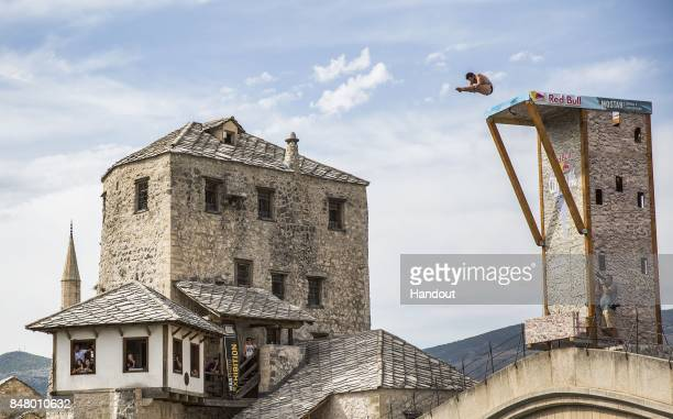 In this handout image provided by Red Bull Steven LoBue of the USA dives from the 27 metre platform on Stari Most during the fifth stop of the Red...