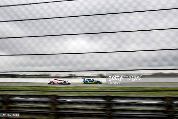 In this handout image provided by Red Bull, the Aston Martin Vantage GT8 and Toyota Gazoo Racing LMP1 during Free Practice 1 of the 6 Hours of...