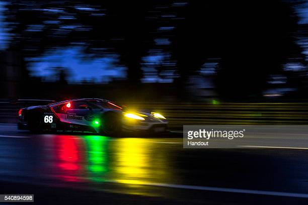 In this handout image provided by Red Bull The Chip Ganassi Ford GT car driven by Sebastien Bourdais of France Joey Hand of the USA and Dirk Muller...