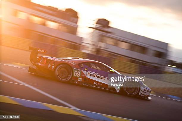 In this handout image provided by Red Bull, The Chip Ganassi Ford GT driven by Ryan Briscoe of Australia, Scott Dixon of New Zealand and Richard...