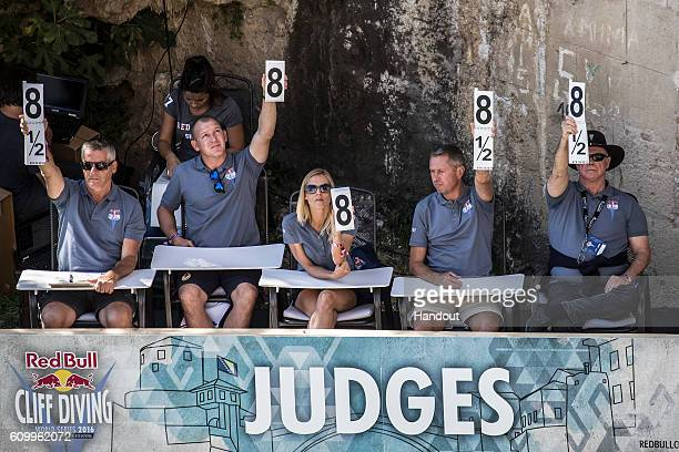 MOSTAR BOSNIA HERZEGOVINA SEPTEMBER 23 In this handout image provided by Red Bull The judges Claudio de Miro of Italy Dmitri Sautin of Russia Anke...