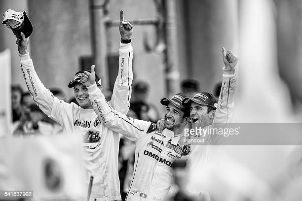 In this handout image provided by Red Bull, The Porsche LMP1 drivers Marc Lieb of Germany, Neel Jani of Switzerland and Romain Dumas of France...