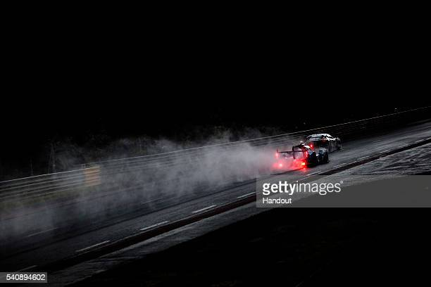 In this handout image provided by Red Bull The SMP Racing Nissan LMP2 pursues the AF Corse Ferrai 458 Italia GTE during the 2nd Qualification session...