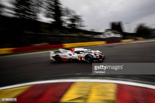 In this handout image provided by Red Bull The Toyota Gazoo Racing LMP1 driven by Sebastien Buemi of Switzerland Anthony Davidson of the UK and...