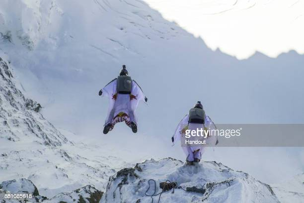 In this handout image provided by Red Bull wingsuit flyers Fred Fugen and Vince Reffet known as the Soul Flyers catching up and fly into a Pilatus...