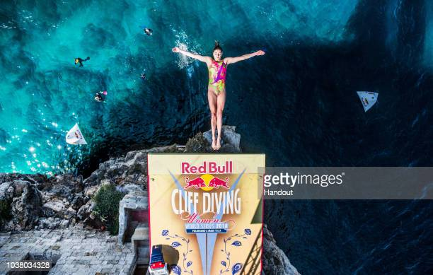 In this handout image provided by Red Bull, Yana Nestsiarava of Belarus dives from the 21 metre platform during the first competition day of the...