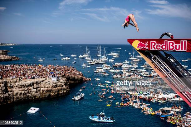 In this handout image provided by Red Bull Yana Nestsiarava of Belarus dives from the 21 metre platform during the last competition day of the...