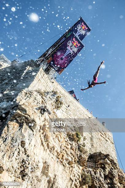 In this handout image provided by Red Bull Yana Nestsiarava of Belarus dives from the 22 metre platform during the seventh stop of the Red Bull Cliff...