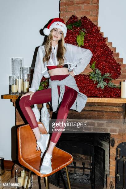 In this handout image provided by Reebok style icon and Reebok ambassador Gigi Hadid hosts an intimate holiday celebration joined by her closest...