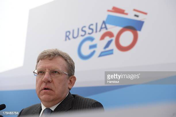 In this handout image provided by Ria Novosti Dean of the Department of Liberal Arts and Sciences Saint Petersburg State University Alexei Kudrin...