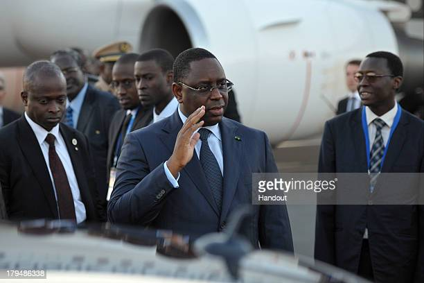 In this handout image provided by RIA Novosti President of Senegal Macky Sall arrives in Russia ahead of the G20 summit on September 4 2013 in St...