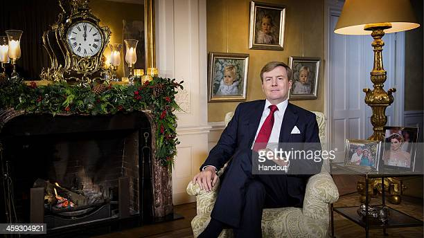 In this handout image provided by Rijks Voorlichtings Dienst , King Willem-Alexander of The Netherlands gives his first Christmas speech to the...