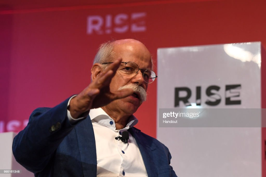 In this handout image provided by RISE, Dieter Zetsche, Chairman of the Board of Management of Daimler AG and Head of Mercedes-Benz Cars speaks on Centre Stage during day one of RISE 2018 at Hong Kong Convention and Exhibition Center on July 10, 2018 in Hong Kong, Hong Kong. RISE is produced by the team behind Web Summit. In 6 short years, Web Summit has become the world's largest tech event with 70,000+ attendees from 170+ countries. People from the world's biggest companies and most exciting startups are at RISE in Hong Kong to share their stories and experiences. They'll be joined by major global media, hundreds of investors and thousands of attendees for three days of legendary networking.