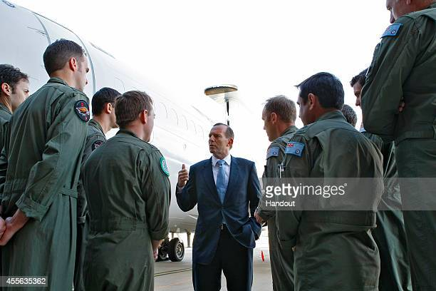 In this handout image provided by Royal Australian Air Force Australian Prime Minister the Hon Tony Abbott MP speaks to deploying troops at RAAF Base...
