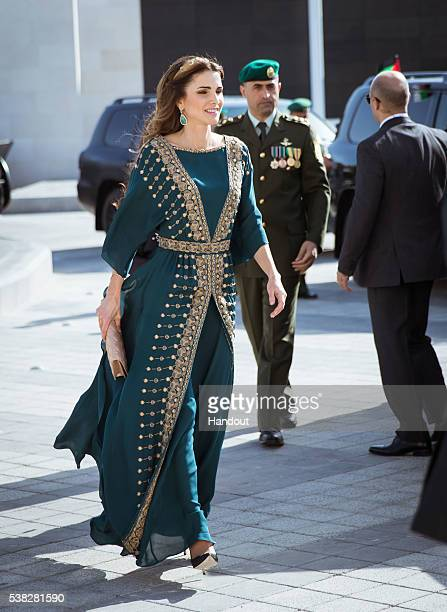 In this handout image provided by Royal Hashemite Court Queen Rania of Jordan attends to celebrate the Great Arab Revolt centennial at Al Rayah...
