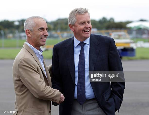 In this handout image provided by Ryder Cup Europe Europe captain Colin Mongomerie welcomes USA captain Corey Pavin at Cardiff Airport prior to the...