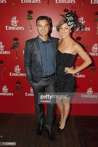 In this handout image provided by SDP Media Guy Sebastian and his wife Jules Egan attend Emirates Doncaster Day at Royal Randwick Racecourse on April...