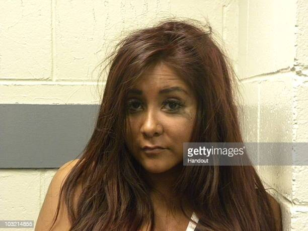 In this handout image provided by Seaside Heights Police Dept 'Jersey Shore' cast member Nicole 'Snooki' Polizzi Poses for a booking photo on July 30...