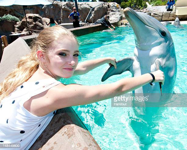 In this handout image provided by SeaWorld San Diego actress Willow Shields dances with her new friend Avalon a bottlenose dolphin at SeaWorld San...
