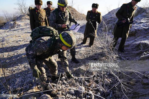 In this handout image provided by South Korean Defense Ministry South Korean soldiers inspecting the dismantled North Korean guard post on inside the...