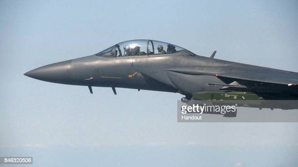 In this handout image provided by South Korean Defense Ministry South Korean Air Force F15K fighter jet flying with a Taurus longrange airtosurface...