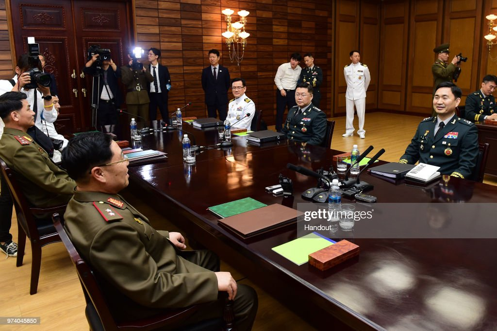 In this handout image provided by South Korean Defense Ministry, South Korean Major. Gen. Kim Do-gyun (R) talks with his North Korean counterpart Lt. Gen. An Ik-san (L) during a meeting on June 14, 2018 in Panmunjom, North Korea. Two Koreas began their first high-level military talks in more than 10 years to discuss ways to ease cross-border tensions.