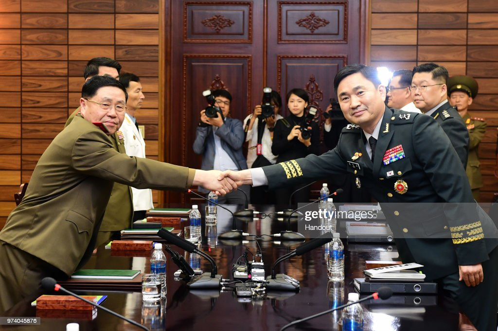 In this handout image provided by South Korean Defense Ministry, South Korean Major. Gen. Kim Do-gyun (R) shakes hands with his North Korean counterpart Lt. Gen. An Ik-san (L) during a meeting on June 14, 2018 in Panmunjom, North Korea. Two Koreas began their first high-level military talks in more than 10 years to discuss ways to ease cross-border tensions.