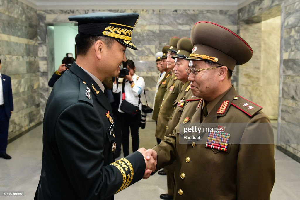 In this handout image provided by South Korean Defense Ministry, South Korean Major. Gen. Kim Do-gyun (L) shakes hands with his North Korean counterpart Lt. Gen. An Ik-san (R) during a meeting on June 14, 2018 in Panmunjom, North Korea. Two Koreas began their first high-level military talks in more than 10 years to discuss ways to ease cross-border tensions.