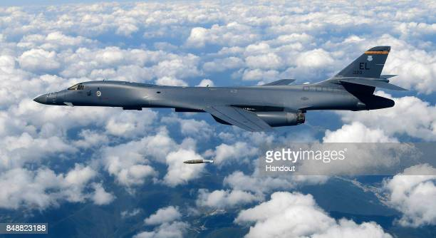 In this handout image provided by South Korean Defense Ministry US Air Force B1B Lancer bomber drop MK84 bomb during a training at the Pilsung Firing...