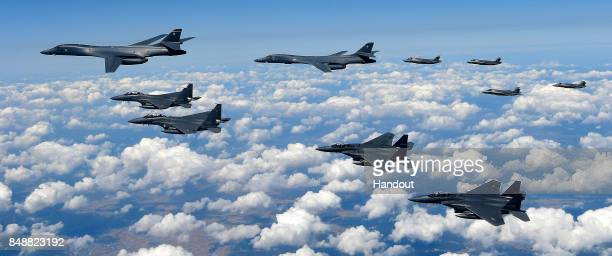 In this handout image provided by South Korean Defense Ministry US Air Force B1B Lancer bombers flying with F35B fighter jets and South Korean Air...