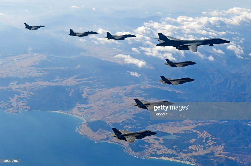 In this handout image provided by South Korean Defense Ministry, U.S. Air Force B-1B bomber (L), South Korea and U.S. fighter jets fly over the Korean Peninsula during the Vigilant air combat exercise (ACE) on December 6, 2017 in Korean Peninsula, South Korea. The largest-scale warplanes and military personnel take part in the annual joint exercise, which was scheduled before the North's latest missile test. North Korea fired a new intercontinental ballistic missile (ICBM) on November 29, believed to have shown capability to reach to the U.S. mainland.