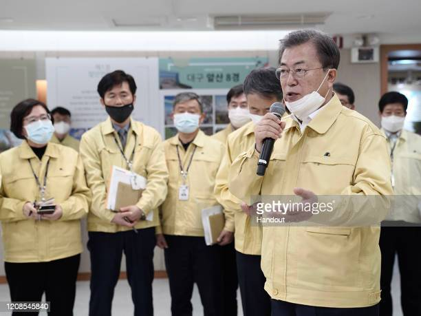 In this handout image provided by South Korean Presidential Blue House, South Korean President Moon Jae-in, talks with government employees during a...
