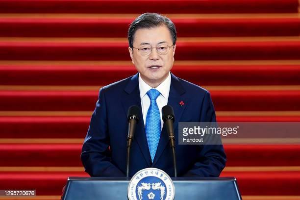 In this handout image provided by South Korean Presidential Blue House, South Korean President Moon Jae-in speaks during his New Year's speech at the...
