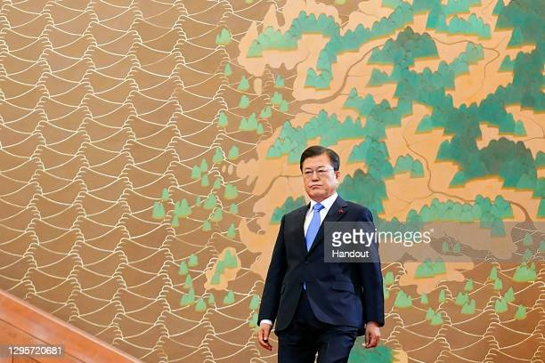 In this handout image provided by South Korean Presidential Blue House, South Korean President Moon Jae-in walks for his New Year's speech at the...