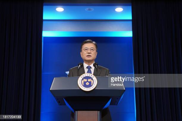 In this handout image provided by South Korean Presidential Blue House, South Korean President Moon Jae-in delivers a special address to mark the...