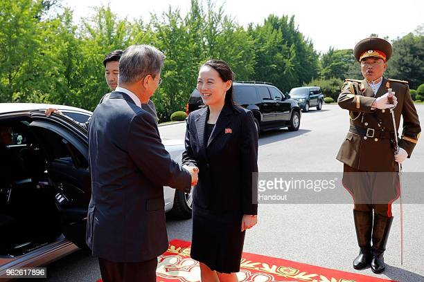 In this handout image provided by South Korean Presidential Blue House, South Korean President Moon Jae-in shakes hands with Kim Yo-Jong sister of...