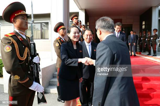 In this handout image provided by South Korean Presidential Blue House South Korean President Moon Jaein shakes hands with Kim YoJong sister of North...