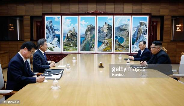 In this handout image provided by South Korean Presidential Blue House, South Korean President Moon Jae-in talks with North Korean leader Kim Jong-un...