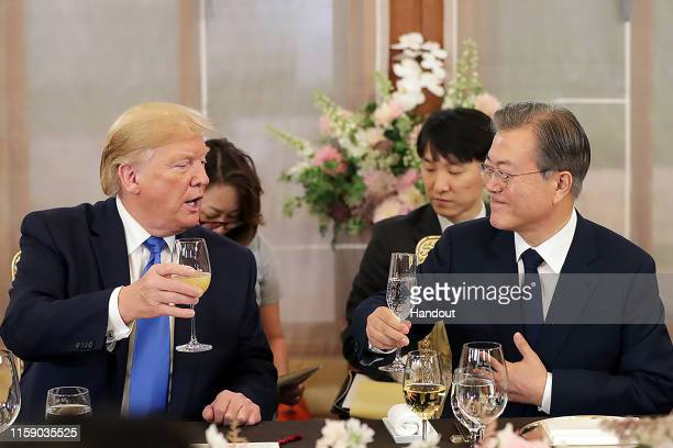 In this handout image provided by South Korean Presidential Blue House US President Donald Trump and South Korean President Moon Jaein attend a...